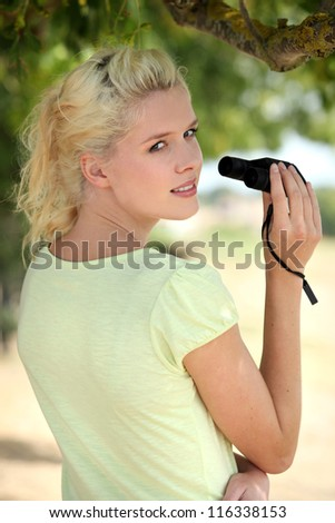 Woman with binoculars - stock photo