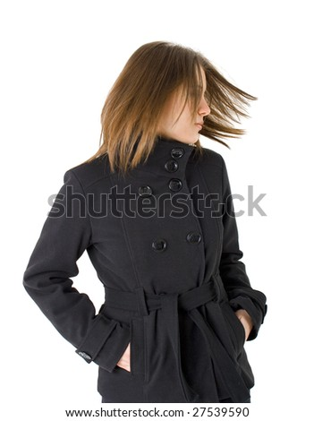 woman with black coat flipping her hair - stock photo