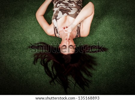 woman with black hair relaxing in a park - stock photo