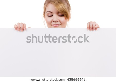 Woman with blank presentation board. Female model showing banner sign billboard copy space for text,  looking down at it. Advertisement concept. - stock photo