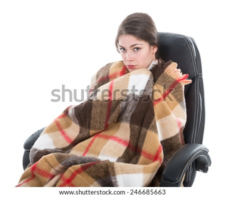 Woman with blanket sitting in armchair, isolated at white background - stock photo
