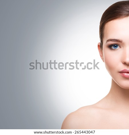 Woman with blue eyes on white background - stock photo