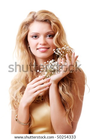 Woman with bouquet of gypsophila flowers - stock photo