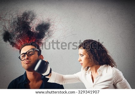 Woman with boxing glove gives a punch - stock photo