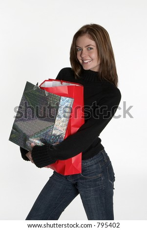Woman with bundle of shopping bags - stock photo