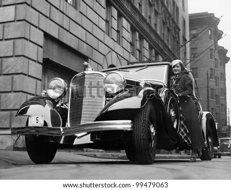 Woman with car on city street - stock photo