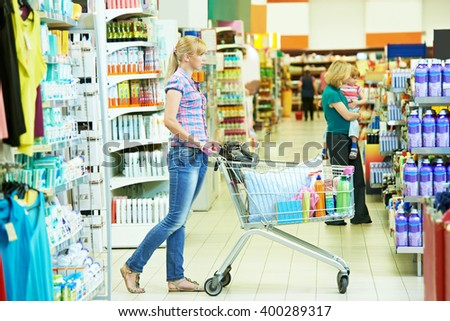 woman with cart shopping - stock photo