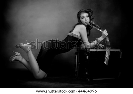 woman with case, black and white - stock photo