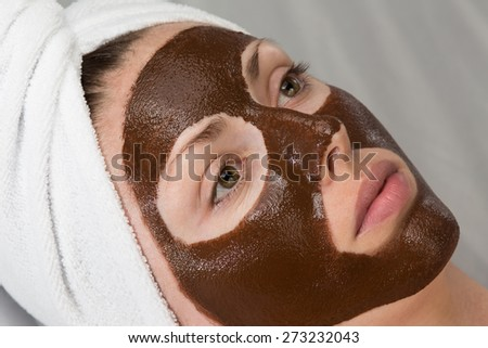 woman with chocolate face-pack - stock photo