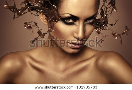 woman with chocolate splash on eyes - stock photo