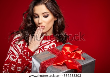 Woman with christmas box gift - stock photo