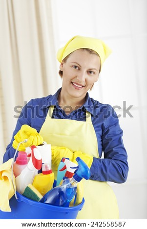 Woman with cleaning supplies - stock photo