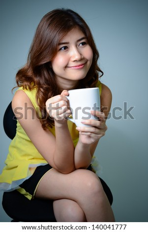 Woman with coffee cup  - stock photo
