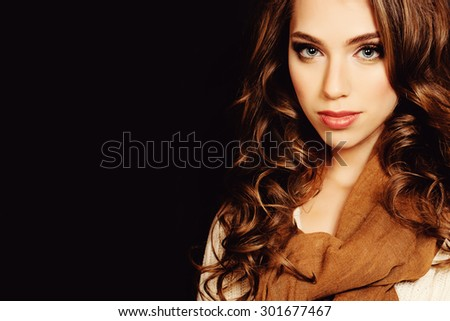 Woman with Coloring Curly Hair. Beautiful Girl Wearing Scarf. Fashion Hairstyle and Make up - stock photo