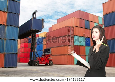 Woman with container cargo inspection in port prior to export. - stock photo