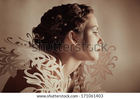 Woman with creative hairdo and makeup - stock photo