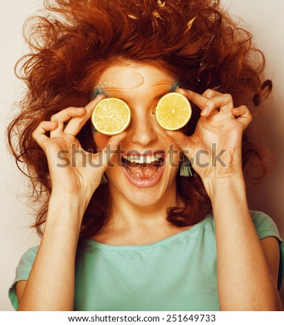 woman with creative make up and lime joking - stock photo