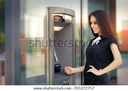 Woman with Credit Card at ATM cash machine - Elegant business woman checking account balance   - stock photo