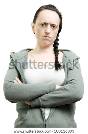 woman with crossed arms not happy and annoyed on a white background - stock photo