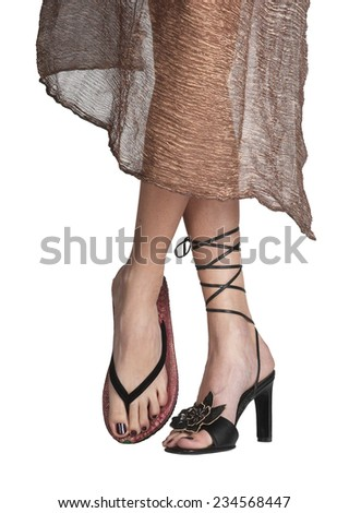 Woman with different shoes - stock photo