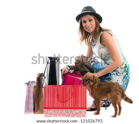 Woman with dog and shopping bags isolated on white background - stock photo