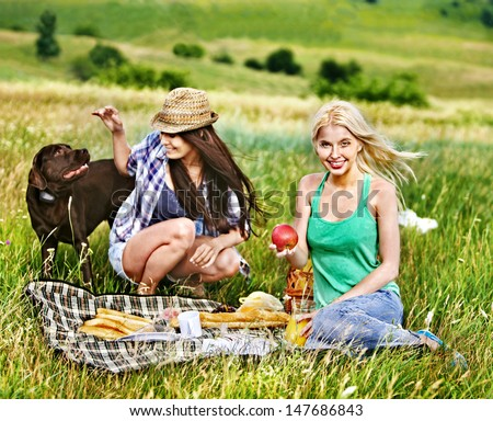 Woman with dog on picnic. Outdoor. - stock photo