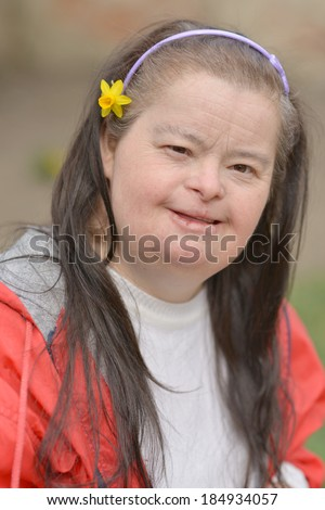 woman with down syndrome with flower - stock photo