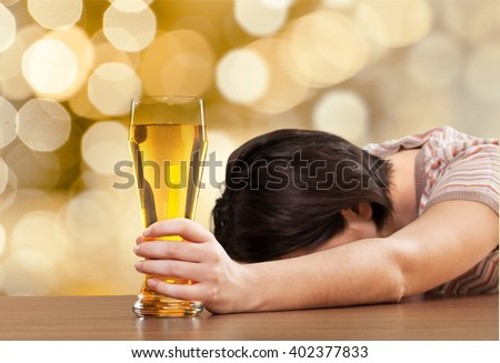 Woman with drinking problem. - stock photo