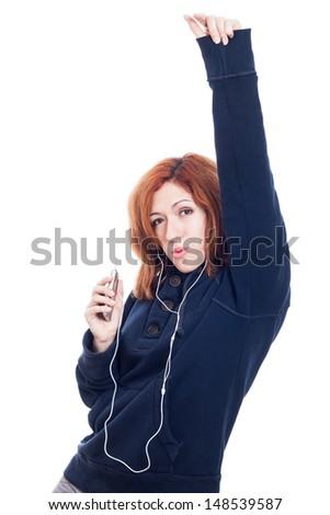 Woman with earphones enjoying music, isolated on white background. - stock photo
