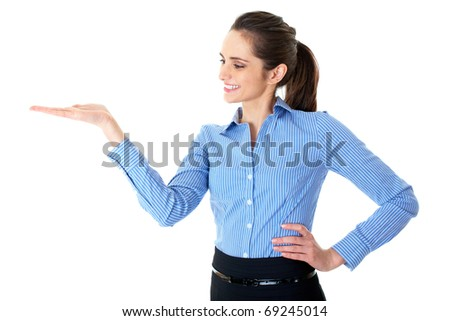 woman with empty hand, copyspace, studio shoot isolated on white - stock photo