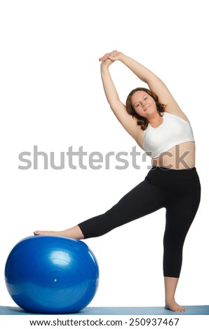 woman with extra weight makes slopes blue ball fitness isolated on white - stock photo