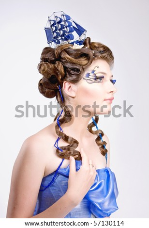 woman with fashion hairstyle and bright stylish make-up - stock photo