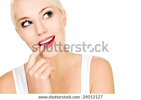 Woman with finger on lip, looking up - stock photo