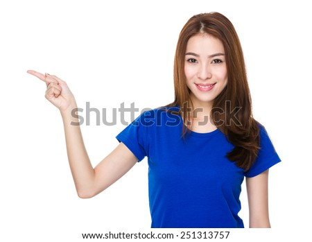 Woman with finger point up - stock photo