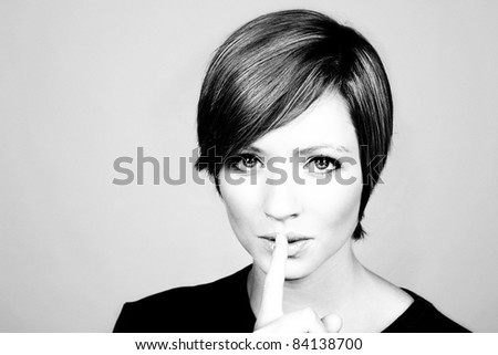 woman with finger up tell the view to be quiet - stock photo