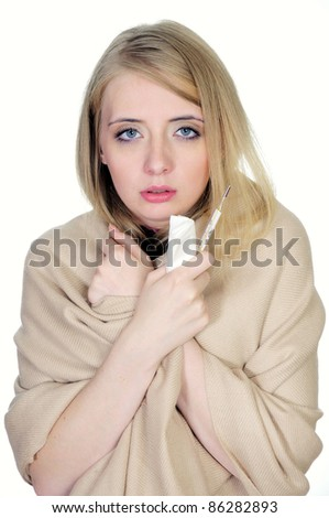 Woman with flue holding thermometer and handkerchiefs - stock photo