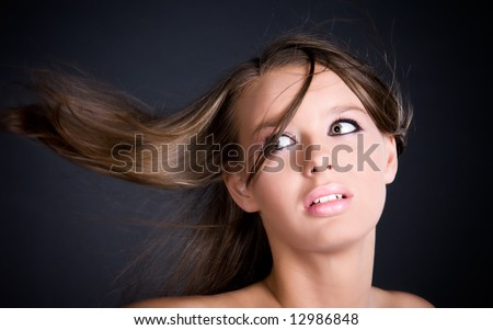 Woman with fluttering hairs portrait. - stock photo