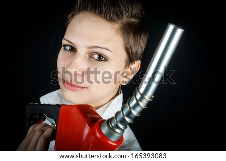 Woman with fuel nozzle closeup - stock photo