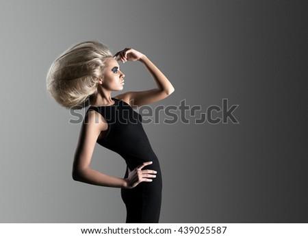 Woman with Futuristic Hairdo - stock photo