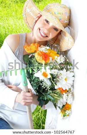 woman with gardening tools - stock photo