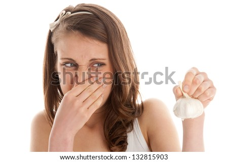Woman with garlic head - stock photo