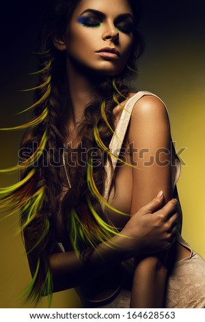 woman with green curls in long braids - stock photo
