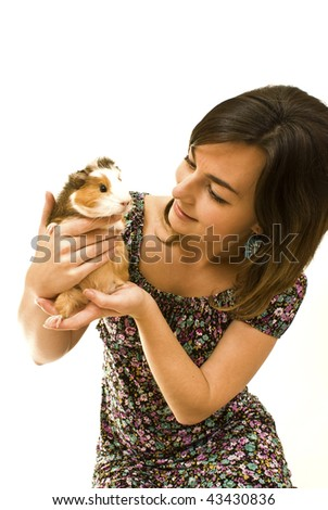 Woman with guinea pig in her hands - stock photo