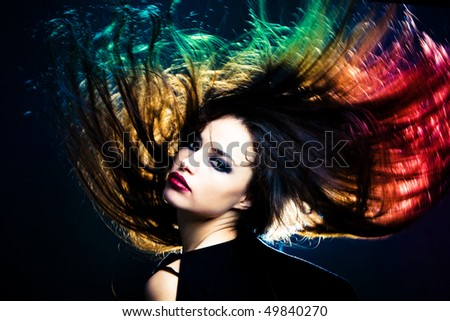 woman with hair in motion, studio shot - stock photo