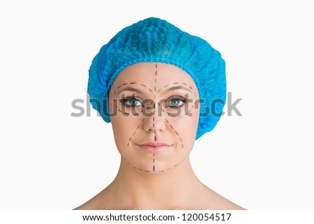 Woman with hair net and black dashes lines for a face lift in the white background - stock photo