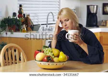Woman with hand on her head as she gazes in thought. Head ache? Depression? Loneliness? Versatile image. - stock photo