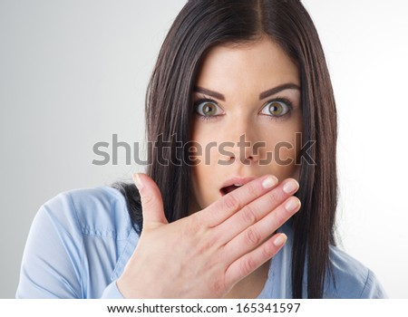 woman with hand over mouth - stock photo