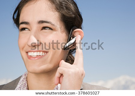 Woman with hands free device - stock photo