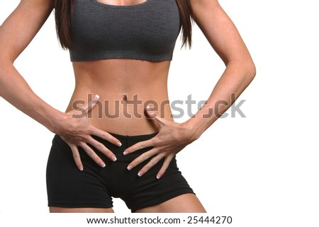 Woman with hands on abs - stock photo