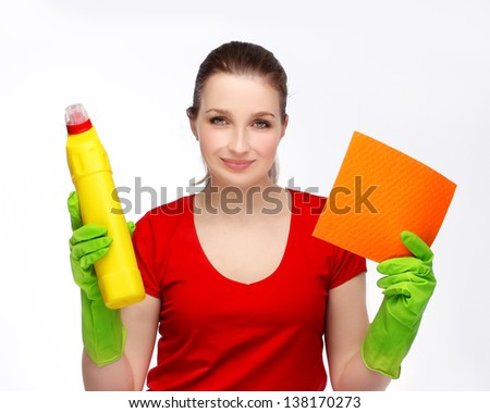 Woman with happy expression holding cleaning supplies - stock photo
